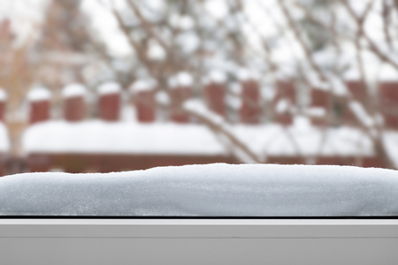 sill: Snow on the window sill