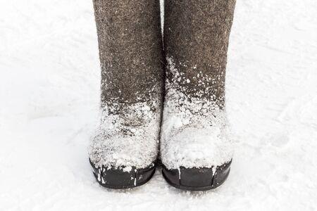 valenki: Winter felt boots in the snow Stock Photo