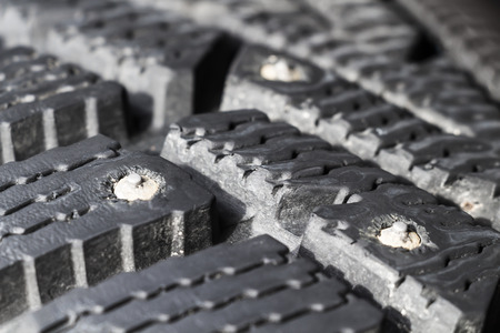 tenon: Tread winter car tire with spikes close-up