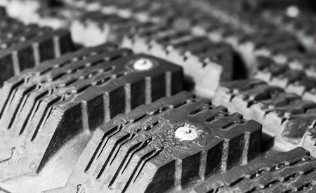 tire tread: Tread winter car tire with spikes close-up