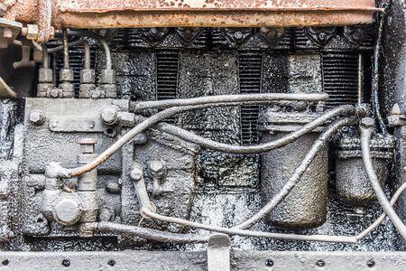 diesel: Old, very dirty, rusty diesel engine closeup