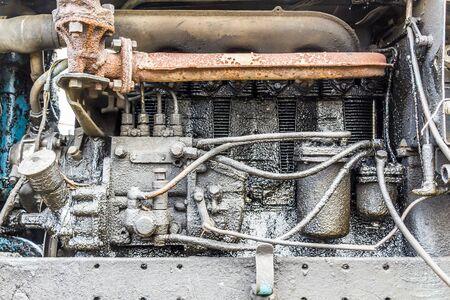 motor car: Old, very dirty, rusty diesel engine closeup
