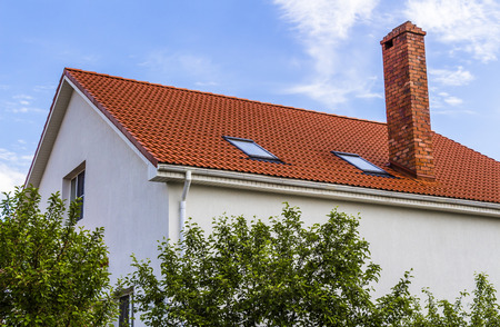The upper part of the house. Roof, inspection windows, chimney. Stok Fotoğraf