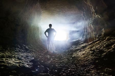 洞窟への入り口の男 写真素材