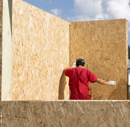 prefabricated buildings: Assembling a small house of SIP panels