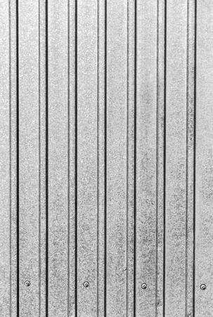 grooved: Part of the surface of the profiled sheet of galvanized steel as the background.