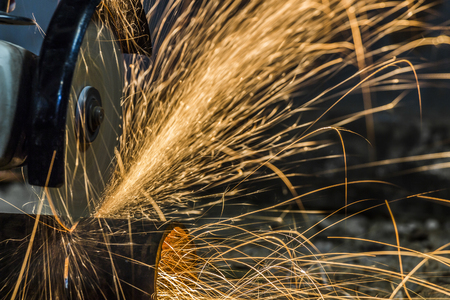 metal cutting: Sparks from cutting metal cutting tool manually.