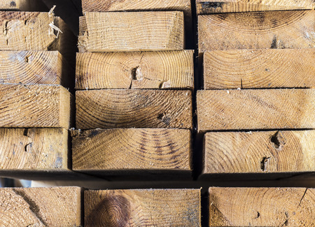 trading floor: A stack of construction planks close up.