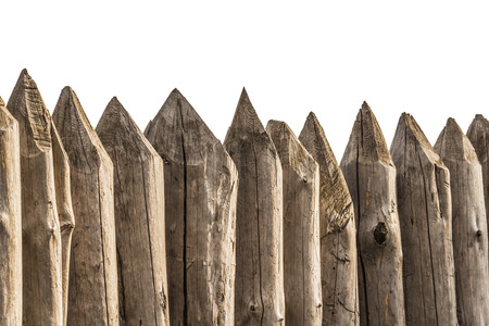 stakes: Protective fence of sharp wooden stakes closeup on a white background. Stock Photo