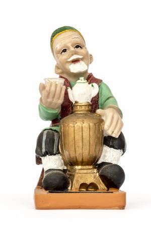 samovar: Figurine hospitable elderly man at the samovar. Stock Photo
