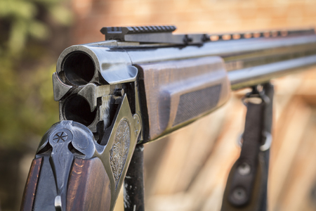 violence in sports: Shutter hunting rifle close-up on a background of nature.