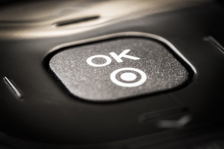 ok button: OK button on the remote control TV and video. Stock Photo