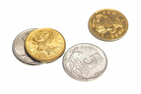 miserly: A few small coins close up on white background. Stock Photo
