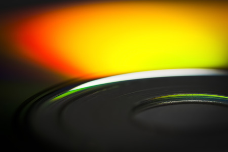spectral: The surface of the CD close-up reflects the spectral colors.
