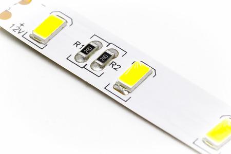 lumen: Part of the LED ribbon closeup on white background. Stock Photo