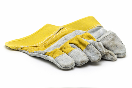 suede: Suede construction gloves closeup on a white background. Stock Photo