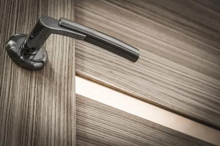 Chrome-plated metal handle interior door close-up. Imagens