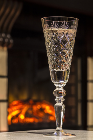 Glass of champagne close-up on the background of fire. Stock Photo