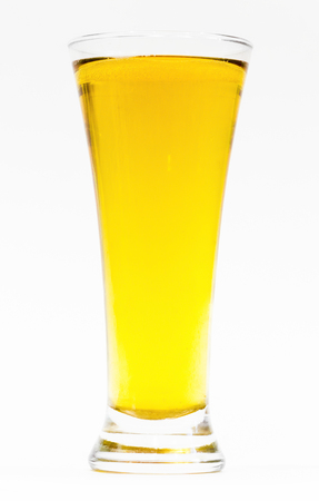 Big glass of beer on a white background close-up.