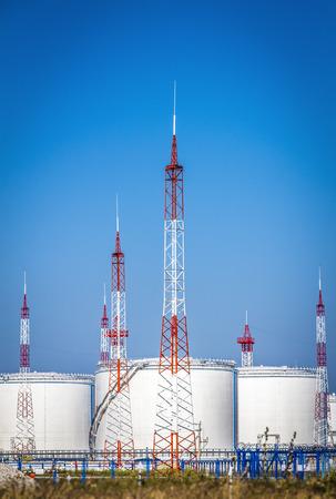 White large oil storage tanks against the blue sky. Stock Photo