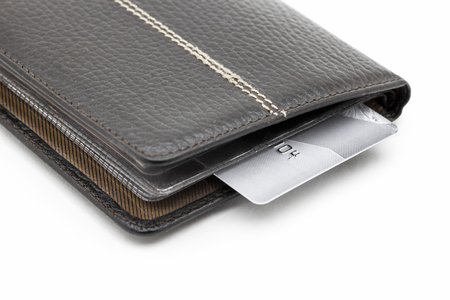 Black leather wallet with credit cards on a white background.