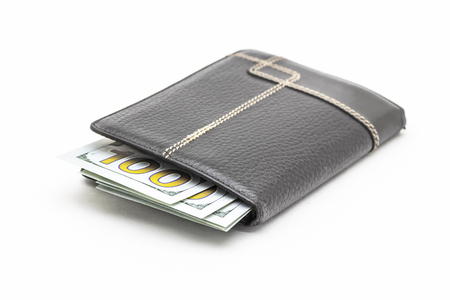 Black leather wallet with cash dollars on a white background.