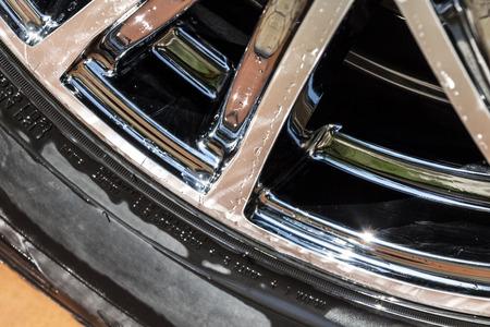 Chrome modern car wheel close-up after washing. Stock Photo