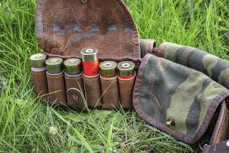 Bandolier with cartridges 12 caliber close-up. 免版税图像
