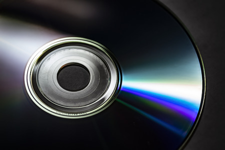 Reflection of the surface of a CD with artistic lighting close-up. Stock Photo - 120923132