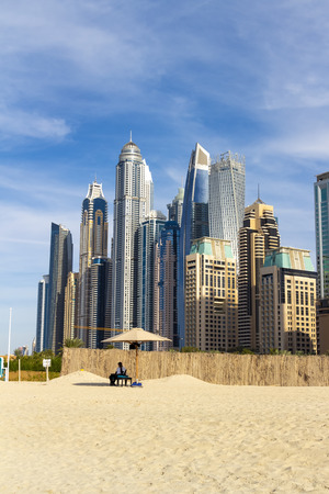 View of the high-rise buildings of Dubai from the beach. Dubai Marina district.