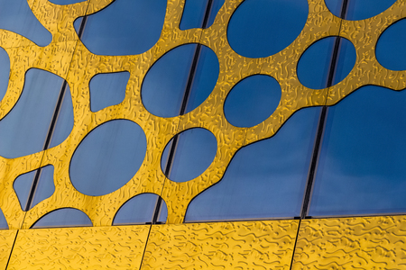 Rich decoration of the outer wall of the building under the gold. Reklamní fotografie