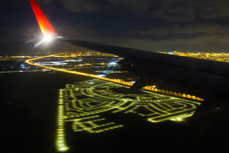 View from the airplane window on the night city. Reklamní fotografie