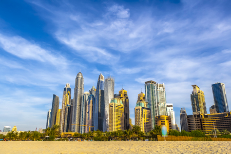 View of the high-rise buildings of Dubai from the beach. Dubai Marina district. 2018. Reklamní fotografie