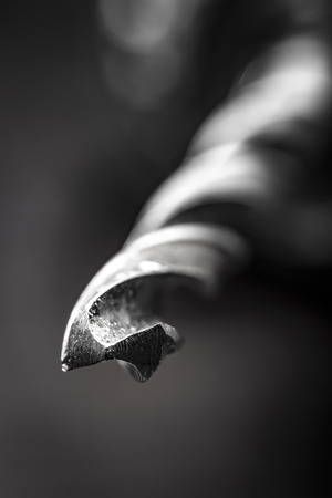 The tip of a sharp drill close-up.