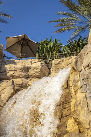 Decorative large waterfall for tourists in the city. 스톡 콘텐츠