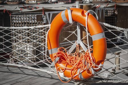 Lifebuoy on the pier on the background of the water taxi. Stok Fotoğraf