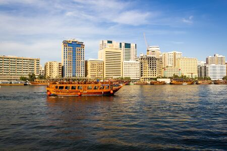 Dubai, UAE - December 1, 2018: Water taxis and pleasure boats. Deira District. Dubai.
