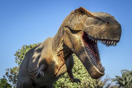 Dubai, UAE - December 3, 2018: Fragments of moving figures of the Dubai Dinosaur Park. Zabeel District.