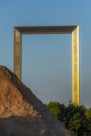 Dubai, UAE - December 3, 2018: The famous Dubai Frame is located in Zabeel Park. It is a museum of history and architectural landmark. View from the Dinosaur Park. Redakční