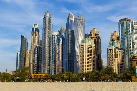 Dubai, UAE - December 2, 2018: View of the high-rise buildings of Dubai from the beach. Dubai Marina district.