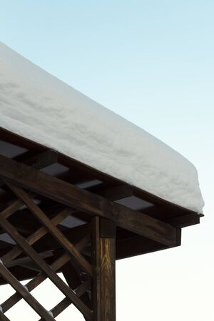 Thick snow on the roof of the gazebo. Stock Photo