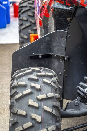 Part of the front suspension of a sports car buggy.