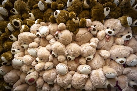 A large pile of teddy bears toys as a background. Imagens