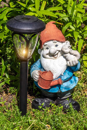 Small garden gnome and LED solar charge lamp.