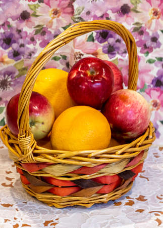 Fruit in a basket on the kitchen table close-up.