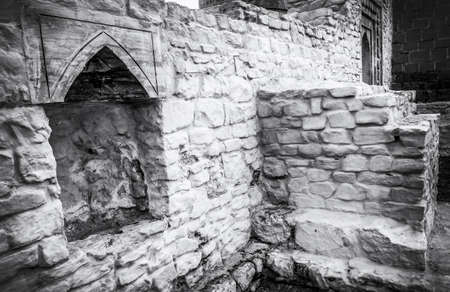 The ruins of the old Arab buildings. Old black and white photo style. Zdjęcie Seryjne