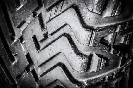 Tread old car tires for off-road close-up. Black and white photo. Zdjęcie Seryjne