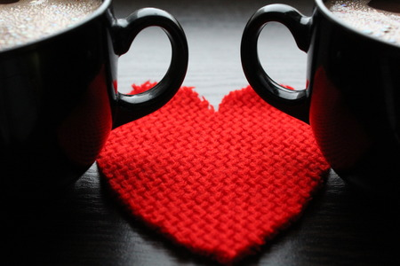 Two cups of coffee and red heart