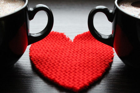 Red heart and two cups of coffee