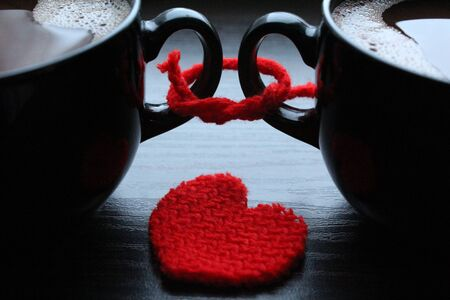 Two cups of coffee and red heart on the table Stock Photo